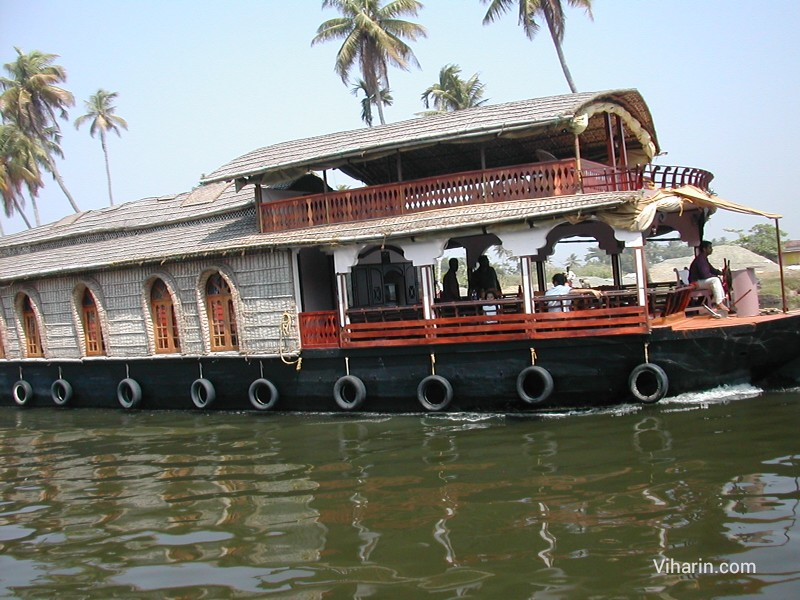 Viharin.com- Houseboat passing by