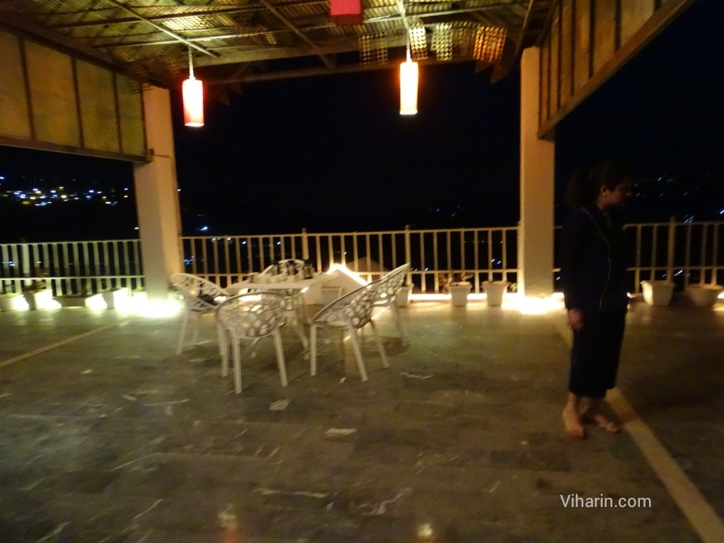 Viharin.com- Experience the dinner at roof top terrace at night in Dunn Perk Manor